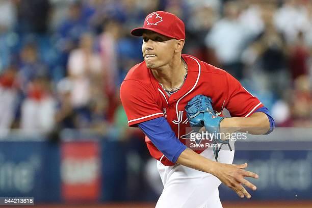 TORONTO ON JULY 1 Toronto Blue Jays second baseman Ryan Goins wearing Marcus Stroman's glove pitches the 18th inning as the Toronto Blue Jays lose...