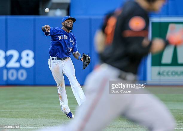 TORONTO ON Toronto Blue Jays shortstop Jose Reyes fields a ground ball from Baltimore Orioles first baseman Chris Davis and get him at first in the...