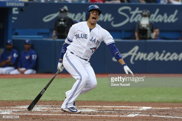TORONTO ON AUGUST 10 Toronto Blue Jays shortstop Ryan Goins reacts after fouling the ball off his foot in the first inning as the Toronto Blue Jays...