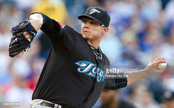 Toronto Blue Jays starting pitcher Brett Cecil throws in the first inning against the Kansas City Royals at Kauffman Stadium in Kansas City Missouri...
