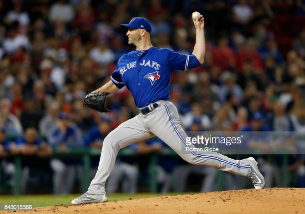 Toronto Blue Jays starting pitcher JA Happ delivers against the Boston Red Sox during the first inning The Boston Red Sox host the Toronto Blue Jays...