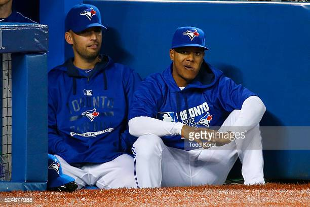 Toronto Blue Jays starting pitcher Marco Estrada and Toronto Blue Jays starting pitcher Marcus Stroman watch in the ninth inning during their Major...