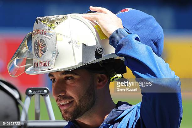 Toronto Blue Jays starting pitcher Marco Estrada is made an honorary fire chief before the game as the Toronto Blue Jays play an afternoon game...