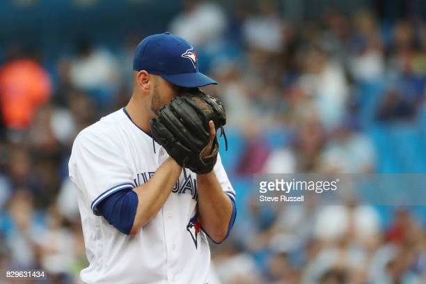 TORONTO ON AUGUST 10 Toronto Blue Jays starting pitcher Marco Estrada looks for a sign from the catch the first inning as the Toronto Blue Jays...