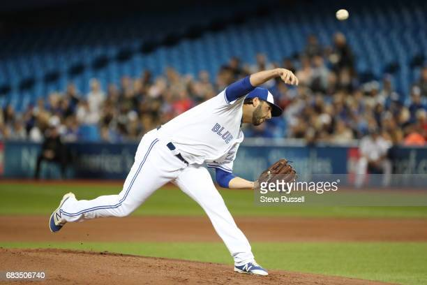 TORONTO ON MAY 15 Toronto Blue Jays starting pitcher Mike Bolsinger throws as the Toronto Blue Jays play the Atlanta Braves at the Rogers Centre in...