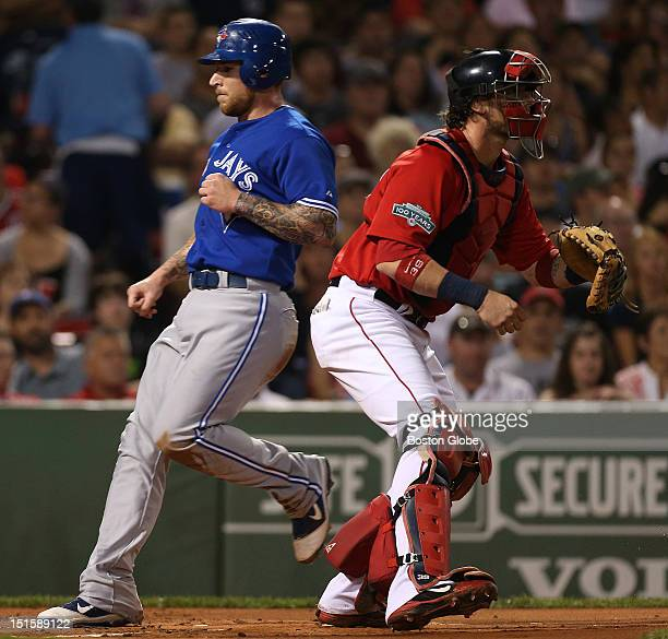 Toronto Blue Jays third baseman Brett Lawrie scores in the first inning as the Boston Red Sox take on the Toronto Blue Jays at Fenway Park.
