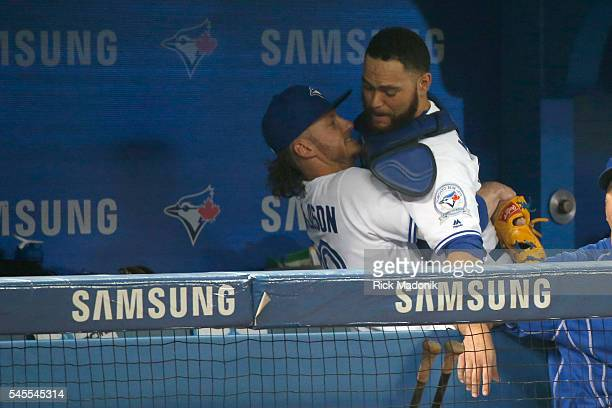 Toronto Blue Jays third baseman Josh Donaldson gives Toronto Blue Jays catcher Russell Martin a lift in the dug out prior to taking the field for the...