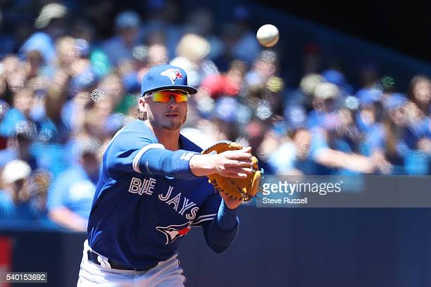 TORONTO ON JUNE 14 Toronto Blue Jays third baseman Josh Donaldson throws out a runner as the Toronto Blue Jays play an afternoon game against the...