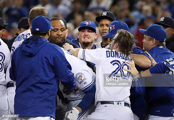 TORONTO ON SEPTEMBER 26 Toronto Blue Jays third baseman Josh Donaldson was the first player hit in the game and tries to get at the Yankees on the...