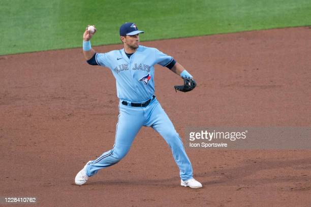 Toronto Blue Jays Third Baseman Travis Shaw throws out New York Yankees Catcher Gary Sanchez after fielding a ground ball during the second inning of...