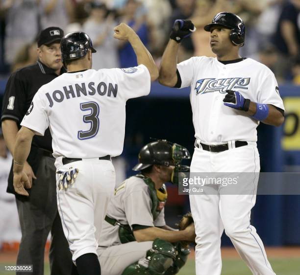 Toronto Blue Jays Vernon Wells exchanges high fives with Reed Johnson after slugging his 29th home run of the season vs the Oakland A's in MLB action...