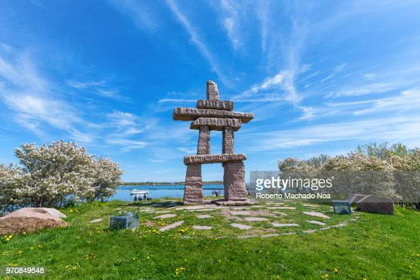 toronto canada: an inuksuk first nations stone monument in exhibition place - wide angle stock pictures, royalty-free photos & images