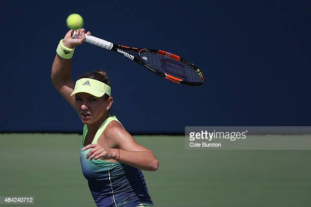 Toronto Canada August 16 Romania's Simona Halep returns a ball to Switzerland's Belinda Bencic during Rogers Cup Tennis finals at the Aviva Centre on...