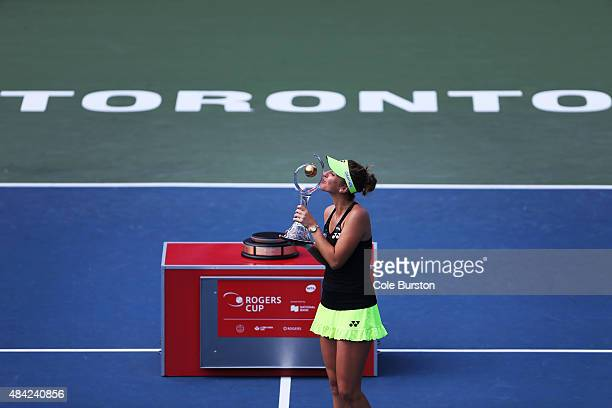 Toronto Canada August 16 Switzerland's Belinda Bencic kisses the Rogers Cup Trophy as she poses for photos after her victory over Romania's Simona...