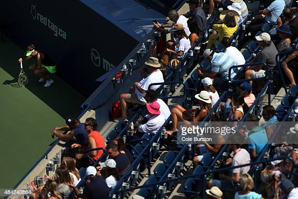 Toronto Canada August 16 Switzerland's Belinda Bencic relaxes in the shade as Romania's Simona Halep takes a timeout during Rogers Cup Tennis finals...