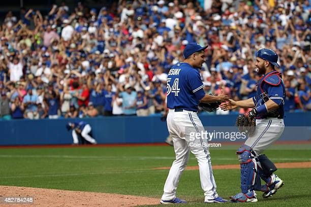 Toronto Canada August 2 Toronto Blue Jays relief pitcher Roberto Osuna and Toronto Blue Jays catcher Russell Martin celebrate a win against the...