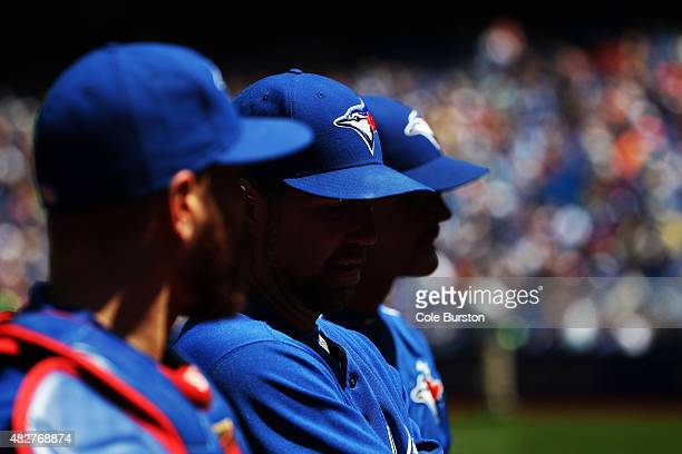 Toronto Canada August 2 Toronto Blue Jays starting pitcher RA Dickey walks out of the bullpen flanked by catcher Russell Martin left and pitching...