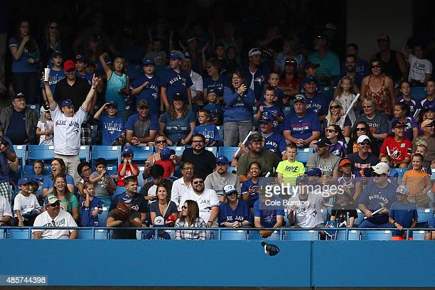 Toronto Canada August 29 A hat falls tot he field after Toronto Blue Jays designated hitter Edwin Encarnacion's grand slam in the 7th inning against...