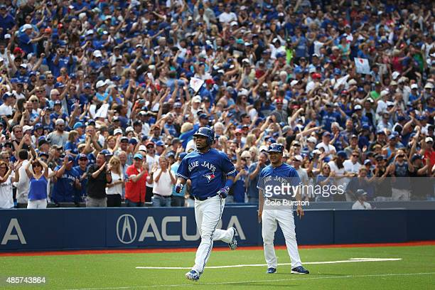 Toronto Canada August 29 Toronto Blue Jays designated hitter Edwin Encarnacion runs in his grand slam in the 7th inning during MLB action against the...