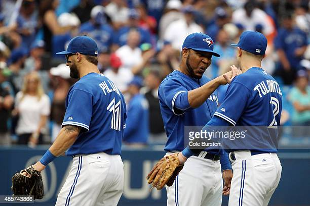 Toronto Canada August 29 Toronto Blue Jays designated hitter Edwin Encarnacion shakes hands with shortstop Troy Tulowitzki during MLB action against...