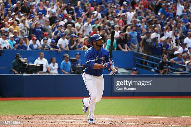Toronto Canada August 29 Toronto Blue Jays designated hitter Edwin Encarnacion looks on after connecting for a grand slam in the 7th inning during...
