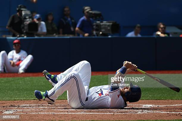 Toronto Canada August 30 Toronto Blue Jays catcher Russell Martin falls to the ground as he hits a foul ball during MLB action against the Detroit...