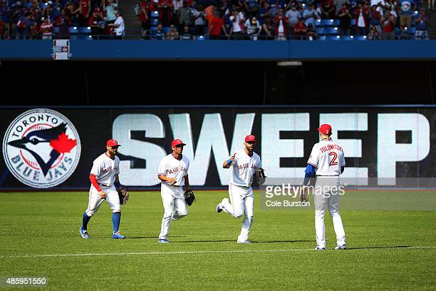 Toronto Canada August 30 Toronto Blue Jays shortstop Troy Tulowitzki waits to celebrate the Jays series sweep over the Detroit Tigers with right...