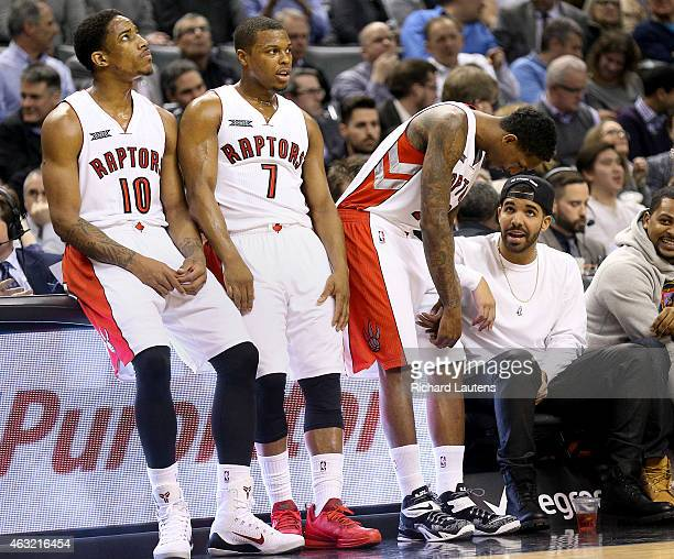 Toronto Canada February 11 In first half action Drake chats with Toronto Raptors guard Louis Williams as DeRozan and Lowry wait out a time out The...