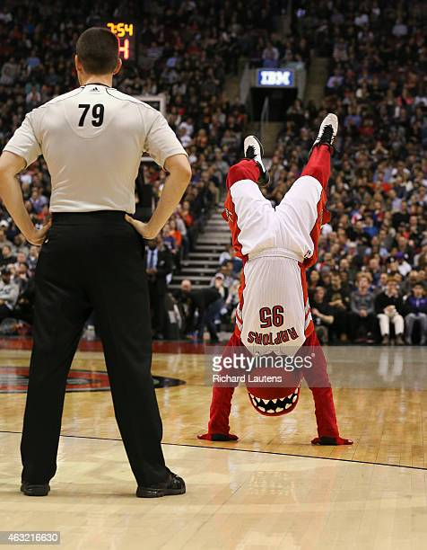 Toronto Canada February 11 In first half action The Raptor does some handstands while being watched by a referee The Toronto Raptors took on the...