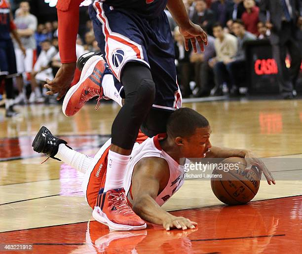 Toronto Canada February 11 In second half action Toronto Raptors guard Kyle Lowry takes a tumble under Washington Wizards guard John Wall The Toronto...