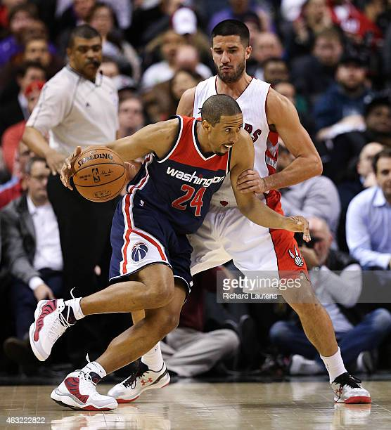 Toronto Canada February 11 In second half action Washington Wizards guard Andre Miller battles with Toronto Raptors guard Greivis Vasquez The Toronto...
