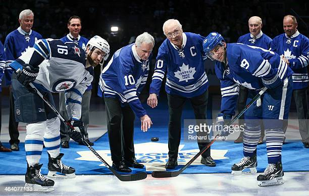 Toronto Canada February 21 Left to right are Andrew Ladd of the Winnipeg Jets Apps Armstrong and Joffrey Lupul of the Toronto Maple Leafs Prior to...