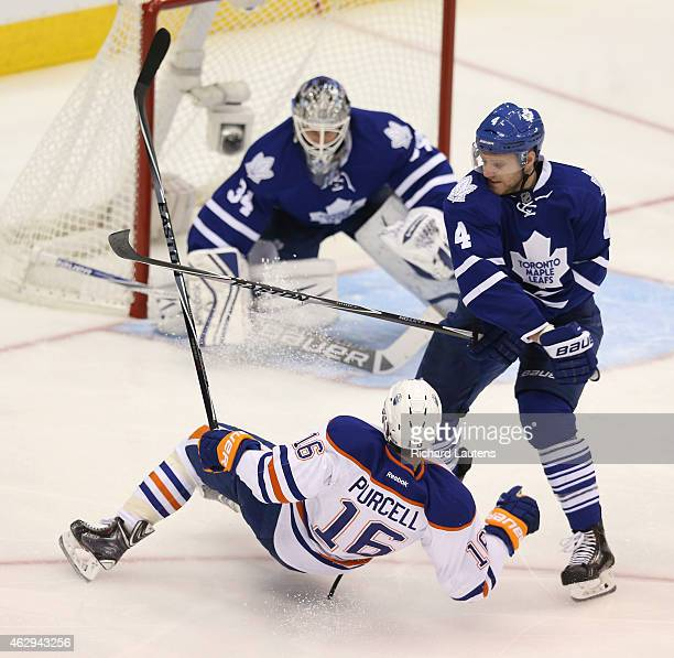 Toronto Canada February 7 In second period action Edmonton Oilers right wing Teddy Purcell gets dumped by Toronto Maple Leafs defenseman Cody Franson...