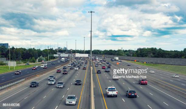 toronto, canada: highway 401 at the height of victoria park avenue in daytime - ontario canada stock photos and pictures
