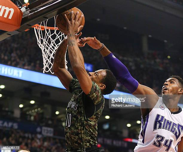 Toronto Canada January 28 In first half action Sacramento Kings forward Jason Thompson plays some tight defence as Toronto Raptors guard DeMar...