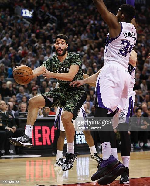Toronto Canada January 28 In first half action Toronto Raptors guard Greivis Vasquez with the interesting pass around Sacramento Kings forward Jason...