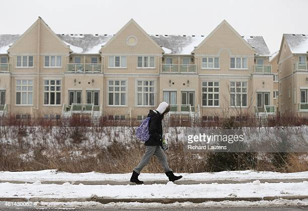 Toronto Canada January 9 A girls walks along one of the quiet streets after school ended Residents of Cathedraltown in Markham have waited more than...