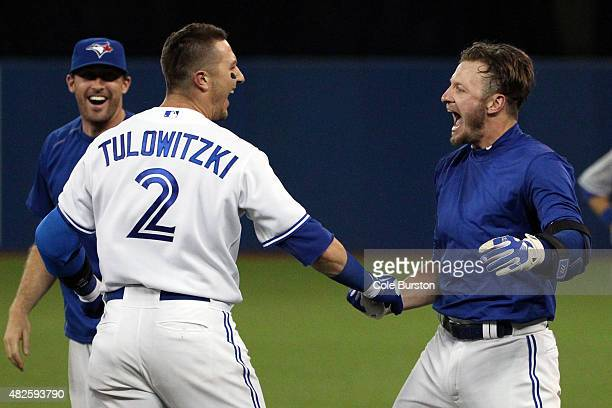 Toronto Canada July 31 Toronto Blue Jays third baseman Josh Donaldson and shortstop Troy Tulowitzki celebrate Donaldson's walk off homer during MLB...