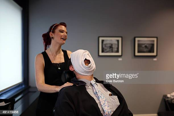 Toronto Canada July 8 Adam McDowell gets a hot towel facial from Heather Wilson at John Allan's a spa type club for men at Yonge and Queen St on July...