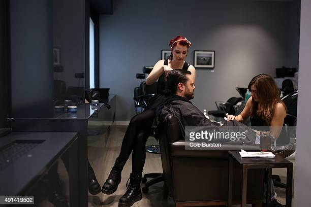 Toronto Canada July 8 Adam McDowell gets pampered by Heather Wilson and manicurist Gayle at John Allan's a spa type club for men at Yonge and Queen...