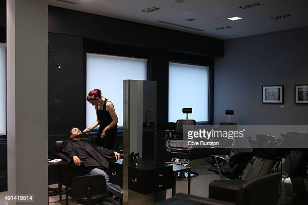 Toronto Canada July 8 Adam McDowell gets pampered by Heather Wilson at John Allan's a spa type club for men at Yonge and Queen St on July 8 2015 Cole...
