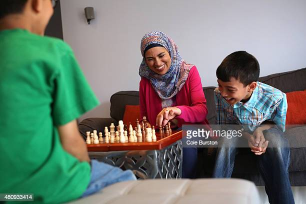 Toronto Canada July 8 Uzma Jalaluddin plays chess with her boys Mustafa right and Ibrahim Merchant in their Markham home on July 8 2015 Cole...
