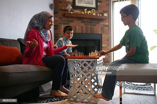 Toronto Canada July 8 Uzma Jalaluddin plays chess with her boys Mustafa left and Ibrahim Merchant in their Markham home on July 8 2015 Cole...
