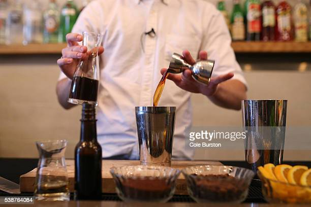 Toronto Canada June 23 Brendan Schatti mixes cold brew coffee into the Cold Shoulder rum and cold brew based cocktail at Thoroughbred on June 23 2015