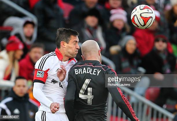 Toronto Canada March 22 In second half action TFCs Michael Bradley connected with DCs Davy Arnaud who was out for the rest of the game The Toronto...