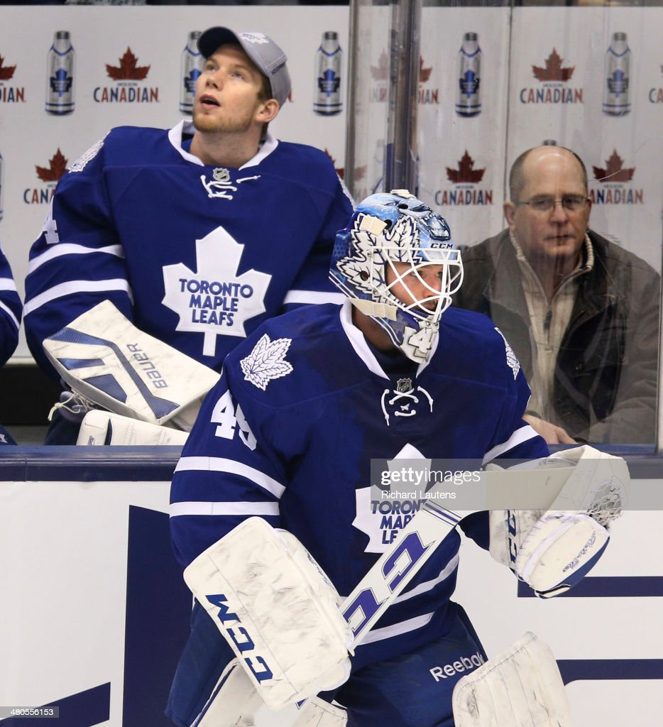 Toronto, Canada - March 25 - In first period action, beleaguered goalie James Reimer sits on the bench as starting goalie Jonathan Bernier heads to the net. The Toronto Maple Leafs took on the St. Louis Blues at the Air Canada Centre in Toronto on Tuesday. March 25, 2014