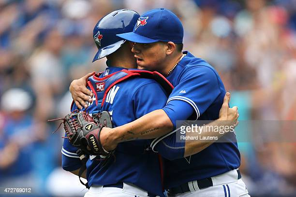 Toronto Canada May 9 Toronto Blue Jays catcher Russell Martin and Toronto Blue Jays relief pitcher Roberto Osuna meet up after the final out The...