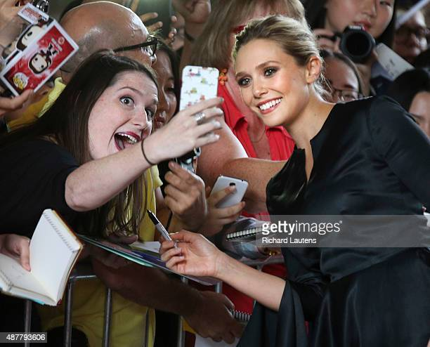 Toronto Canada September 11 2015 Actress Elizabeth Oslen poses for a selfie on the red carpet LIGHT movie red carpet at the Ryerson Theatre Expected...