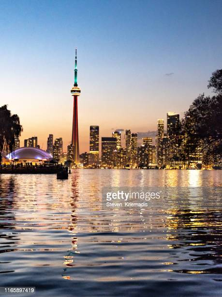 toronto city skyline at dusk - toronto stock pictures, royalty-free photos & images