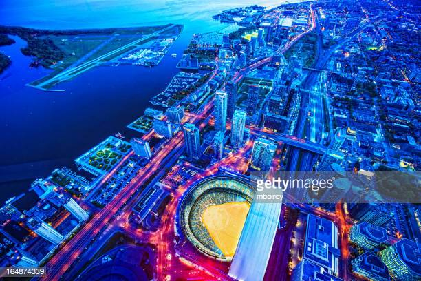 toronto cityscape with baseball stadium at dusk - baseball sport stock pictures, royalty-free photos & images
